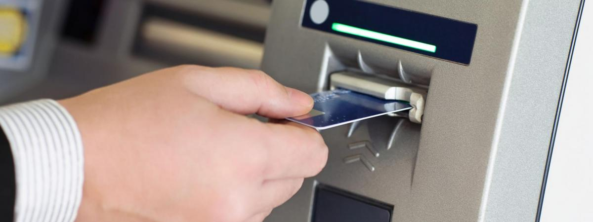 Debit Card being inserted into ATM